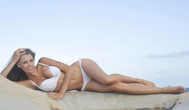 Beauty in white bikini royalty free stock images