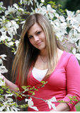 Beauty in White Blossoms. Young woman with long hair admiring spring blossoms Stock Photos