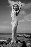 Beauty in white crochet dress on the beach Stock Photos