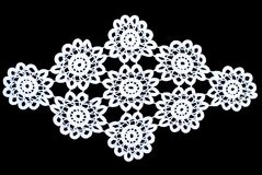 Beauty white lace tablecloth isolated on black background, floral pattern. Cute out and texture for design. White pattern doily Royalty Free Stock Photos