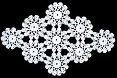 Beauty white rhomboid lace tablecloth isolated on black background, circle pattern. Cute out and texture for design. White pattern doily stock image