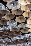 The beauty of white umbrellas illuminated by Christmas lights decorating the streets of Agueda Portugal.  stock photography