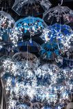 The beauty of white umbrellas illuminated by Christmas lights decorating the streets of Agueda Portugal.  stock images