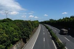 The beauty of the wide highway. Beautiful wide highway with blue sky and white clouds in ya an Mingshan Stock Photos