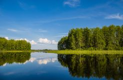 Beautiful landscape with reflection on a lake in wild Russia. royalty free stock photo
