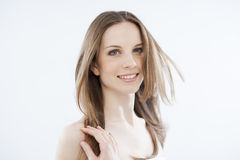 Beauty with windy hair on white Royalty Free Stock Image
