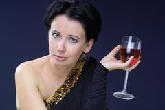 Beauty and wine. Beautiful sexy lady with glass of red wine in her hand Royalty Free Stock Images