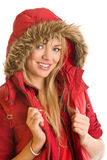 Beauty winter girl. Portrait of beauty winter girl wearing hooded parka isolated on white background Royalty Free Stock Images