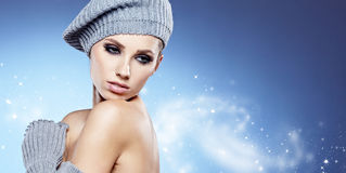 Beauty winter girl. On the blue  background Royalty Free Stock Photos