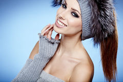 Beauty winter girl. On the blue  background Stock Images