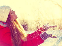 Beauty winter girl. Blowing snow in frosty winter park Stock Image