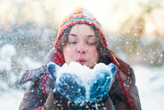 Beauty Winter Girl Blowing Snow in frosty Park. Beauty Winter Girl Blowing Snow in frosty winter Park - Flying Snowflakes - Sunny day - Backlit - Young woman Stock Images