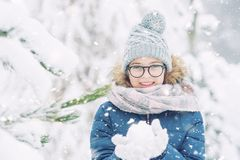 Beauty Winter Girl Blowing Snow in frosty winter park or outdoor. S. Girl and winter cold weather Royalty Free Stock Photo
