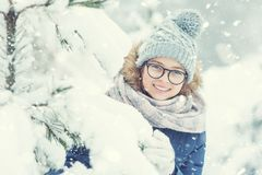 Beauty Winter Girl Blowing Snow in frosty winter park or outdoor. S. Girl and winter cold weather Stock Images