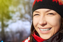 Beauty Winter Girl Blowing Snow in frosty winter Park.  Royalty Free Stock Image