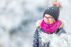 Beauty Winter Girl Blowing Snow in frosty winter park or outdoors. Girl and winter cold weather Stock Photography