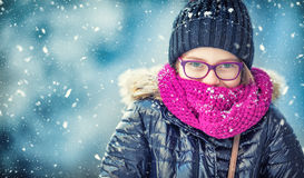 Beauty Winter Girl Blowing Snow in frosty winter park or outdoors. Girl and winter cold weather Stock Photo