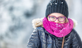 Beauty Winter Girl Blowing Snow in frosty winter park or outdoors. Girl and winter cold weather.  Royalty Free Stock Images