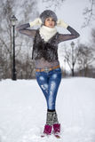 Beauty Winter Girl in frosty winter Park. Outdoors. Flying Snowf. Girl playing with snow in park Stock Photos