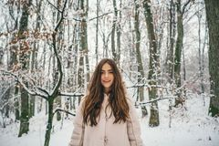 Beauty Winter Girl in frosty winter Park. Winter woman fan. Winter woman snow. Outdoors. royalty free stock photos