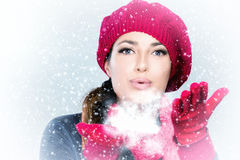 Beauty Winter Woman Blowing Snow. Winter woman in red blowing snow Stock Photos