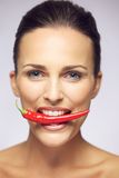 Beauty With Hot Pepper In Her Mouth Stock Photos