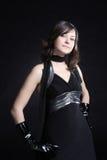 Beauty woman. Fashion black dress on pretty young woman Stock Image