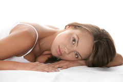 Beauty woman. Young beauty woman lying on stomach isolated on white background Royalty Free Stock Photos