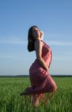 Beauty woman against sky during sunset Royalty Free Stock Photo