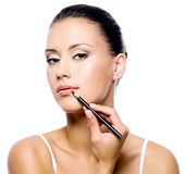 Beauty woman applying lipstick Stock Photo