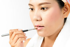 Beauty woman applying lipstick Royalty Free Stock Image