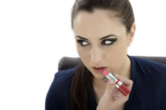 Beauty woman applying lipstick on lips - isolated Stock Images