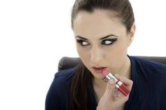 Beauty woman applying lipstick on lips - isolated Stock Images