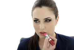 Beauty woman applying lipstick on lips - isolated Royalty Free Stock Photo