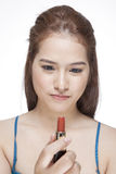 Beauty woman applying lipstick Stock Images