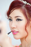Beauty Woman Applying Lipstick On Lips With Brush. Stock Photos