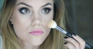 Beauty woman applying makeup. stock video