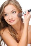 Beauty woman applying powder on face Stock Photography