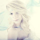 Beauty woman as snow queen in winter Royalty Free Stock Photos