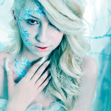 Beauty woman as snow queen in winter Royalty Free Stock Image