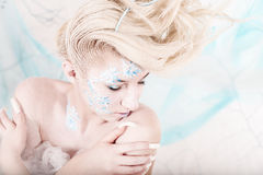 Beauty woman as snow queen in winter Stock Photography
