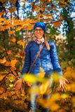 Beauty woman at autumn park Stock Photography