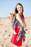 Beauty woman with a baby in a sling. Mom and baby. Mother and ch. Beautiful women with a baby in a sling. Mom and baby. Mother and child Stock Photos