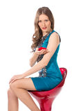 Beauty woman on a bar chair in a blue dress Stock Image