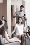 Beauty woman in barber shop Stock Photography
