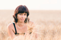 Beauty woman in barley field Royalty Free Stock Image