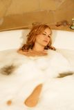 Beauty woman in bath stock photos