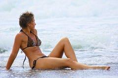 Beauty woman on the beach Stock Photos