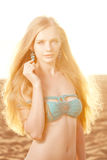 Beauty woman on the beach at sunset Royalty Free Stock Photo