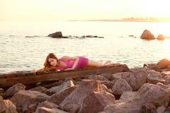 Beauty woman on the beach at sunset. Enjoy nature. Luxury girl r Stock Photo